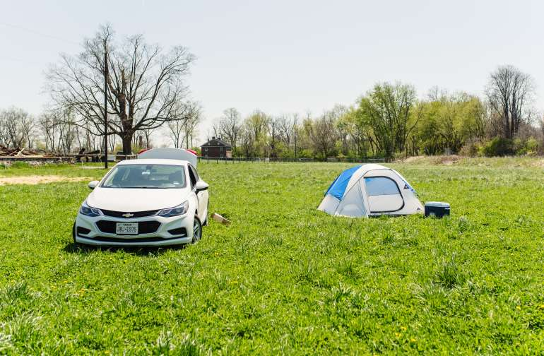 There is convenient access to easily drive your vehicle onto the open field to park next to your tent.