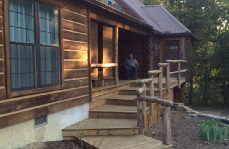 Stay in a beautiful log cabin over looking the creek with all  amenities