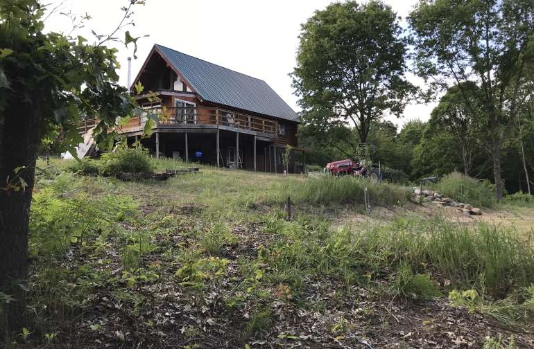 The backside of our log home. The view from the tiny house.