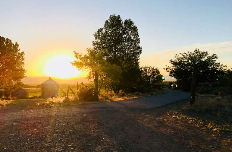 Entry drive to Boot Hill Farms. Always beautiful sunrises. (Campsite just the other side of viewable silos.)