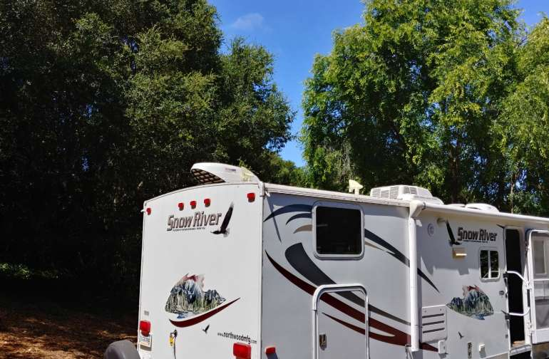 RV set up in the woods