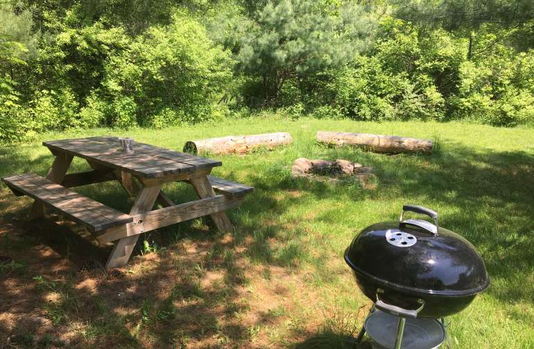 The Bramble site includes firepit, picnic table, and charcoal grill for your private use