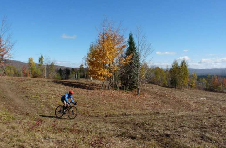Biking by Campsite #1 in the field..