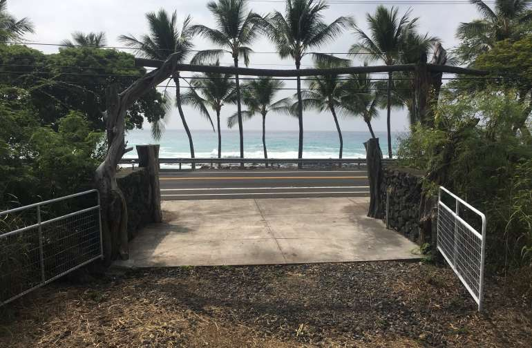 Looking out the front gate over the ocean.