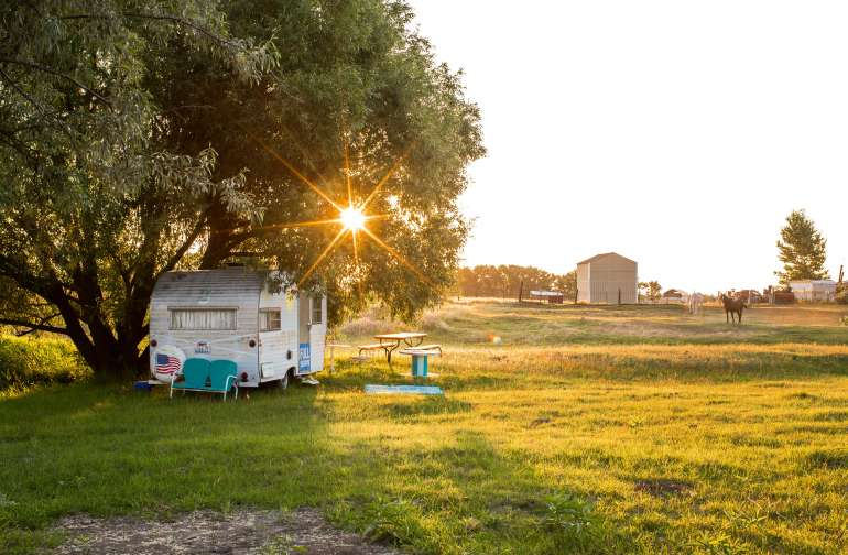 vintage camper at sunrise