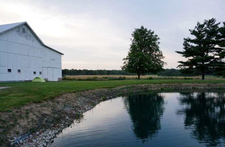 The barn alongside the pond.
