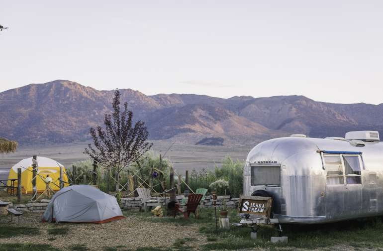 The airstream is perched at the front of the property (my tent is the grey one, the yellow one is another camper's site.) You can park right beside.