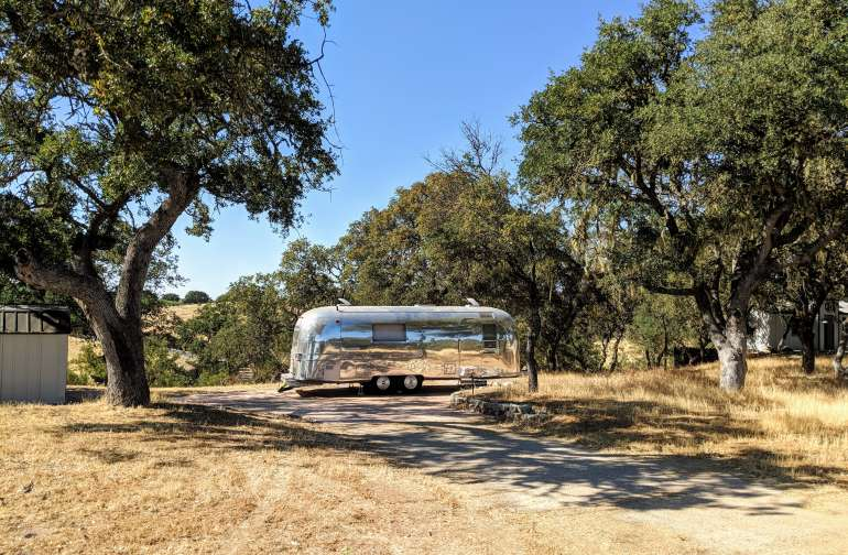 Zeppelin sits on her own concrete pad surrounded by moss covered oaks and with views of rolling hills, vines, and wildlife.