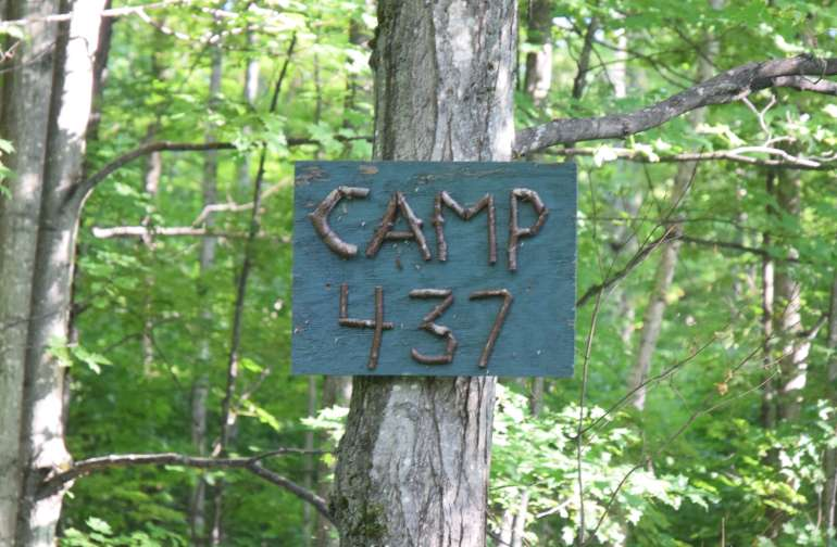 Camp 437 is rustic, wooded camping.  Take a walk to the river to collect your own water, cook your dinner over a campfire, and experience nature with no one camping right next to you!