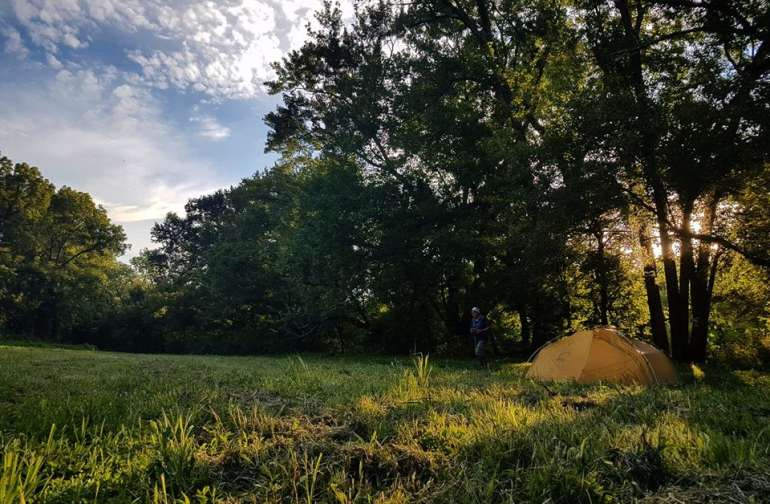 Tent in Frisbee Field as the sun goes down.