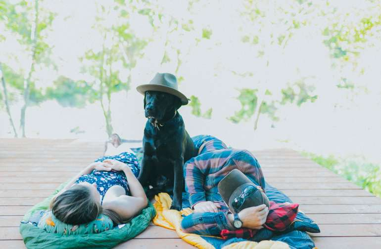 Camp on our deck overlooking the river, and bring your dog!