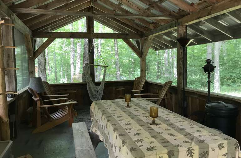 Screened-in cookhouse for meals.
