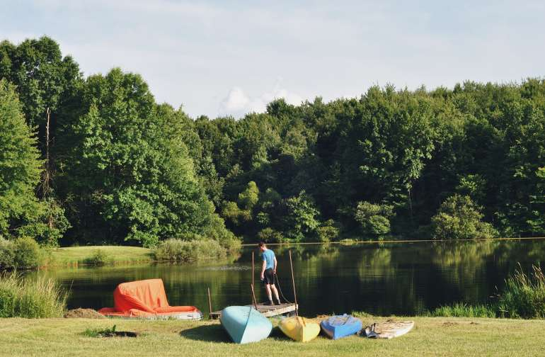 kayaks, a canoe, paddle board and even a floating tent available to guests.