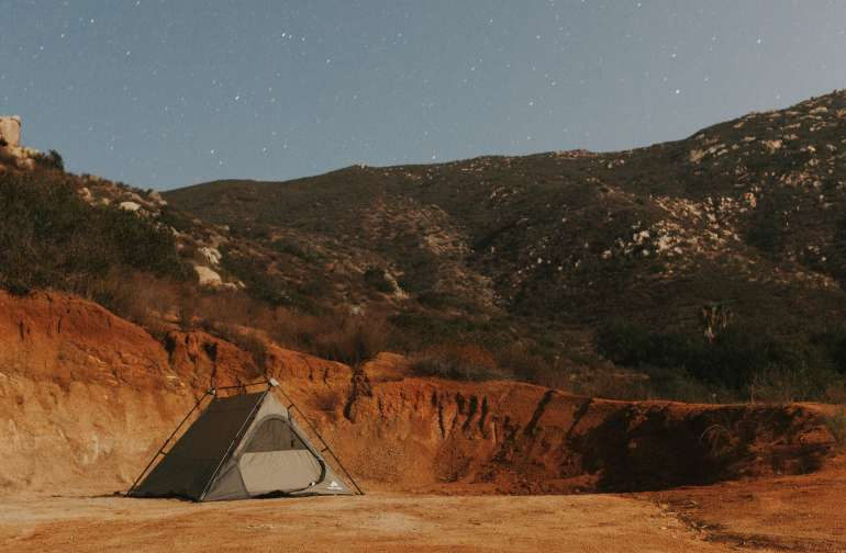 Tent under the light of the moon and stars