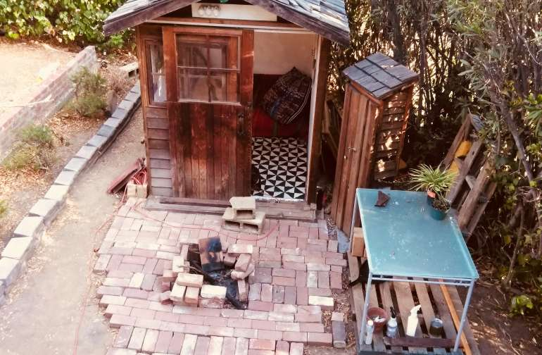 cute tiny house in suberban yard