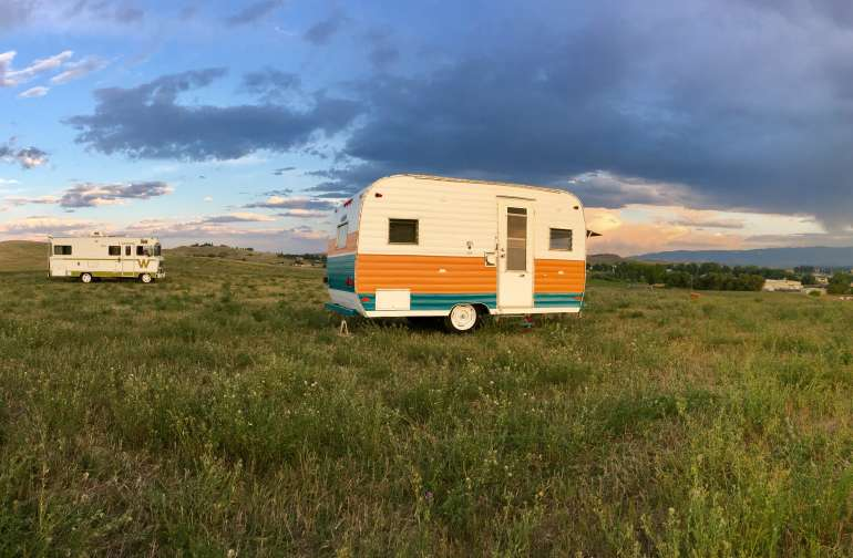 "The Winnebago ""Indian"" and Aloha Camper enjoying the lovely day along the Bighorn Mountains."