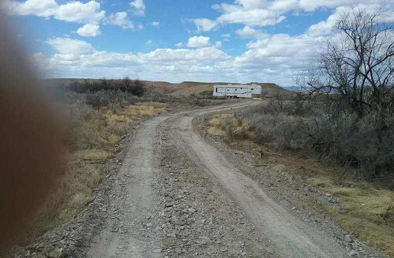 """The driveway up to the """"dirt Circle"""" where you will camp! You can see our camper parked at the south west end of the dirt circle!"""