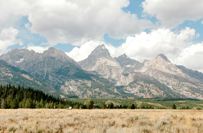 Just a short drive from the beautiful Grand Tetons (pictured in the park, here), and only a bit further north to Yellowstone.