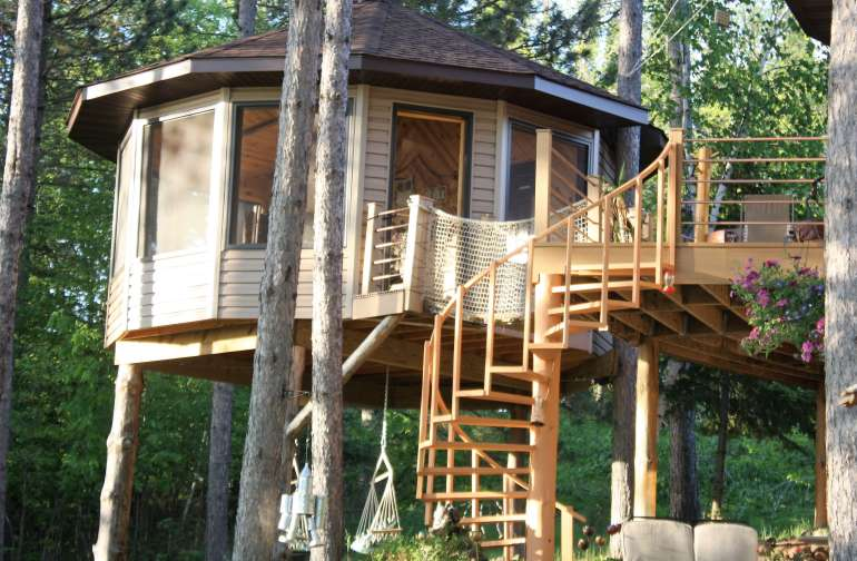 The tree house faces the lake next to our home where we live full time.